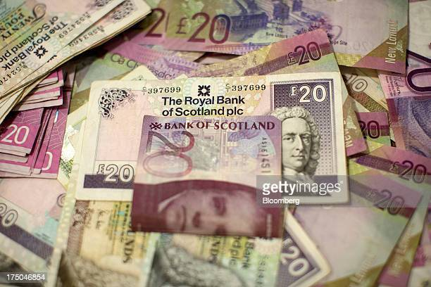Collection of Royal Bank of Scotland Group Plc and Bank of Scotland Plc twenty pound banknotes are displayed this arranged photograph at a Travelex...
