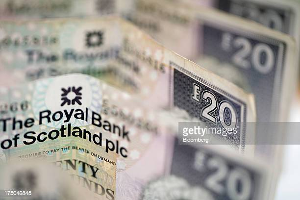 Collection of Royal Bank of Scotland Group Plc twenty pound banknotes are displayed in this arranged photograph at a Travelex Holdings Ltd. Store in...