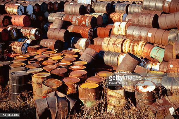 Collection of Rusted Oil Barrels
