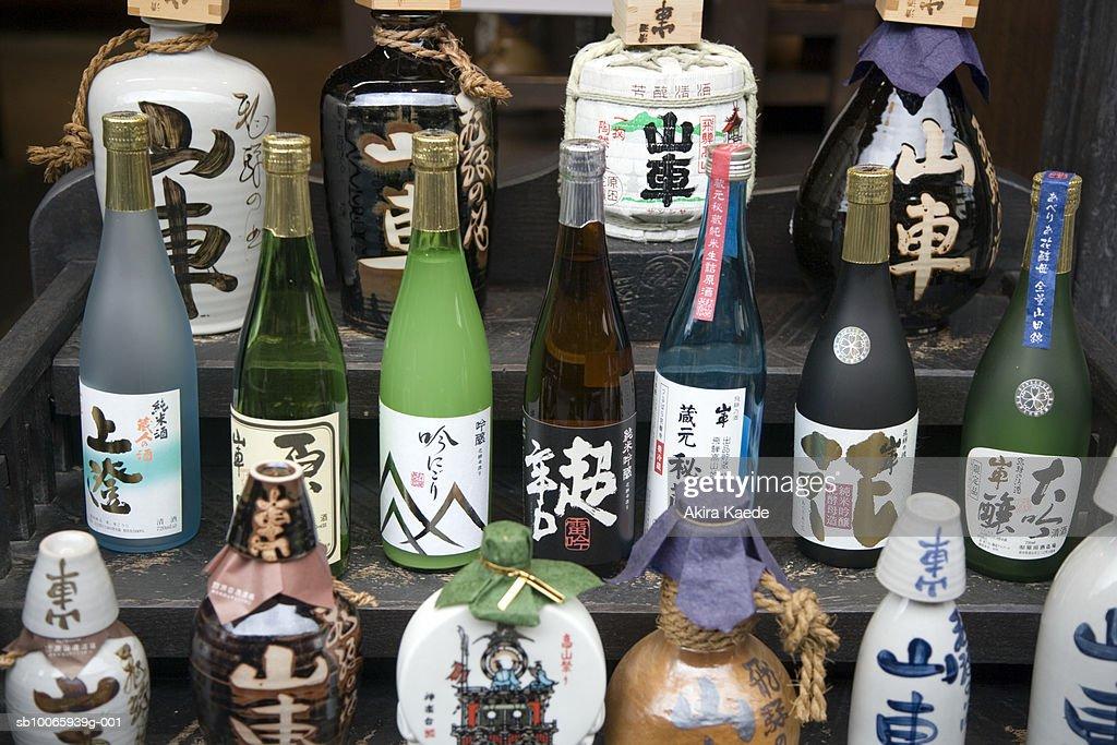 Collection of sake bottles on steps : Stock Photo
