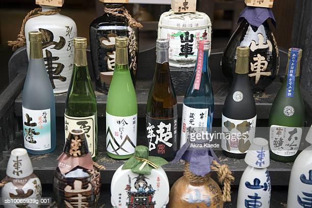 Collection of sake bottles on steps