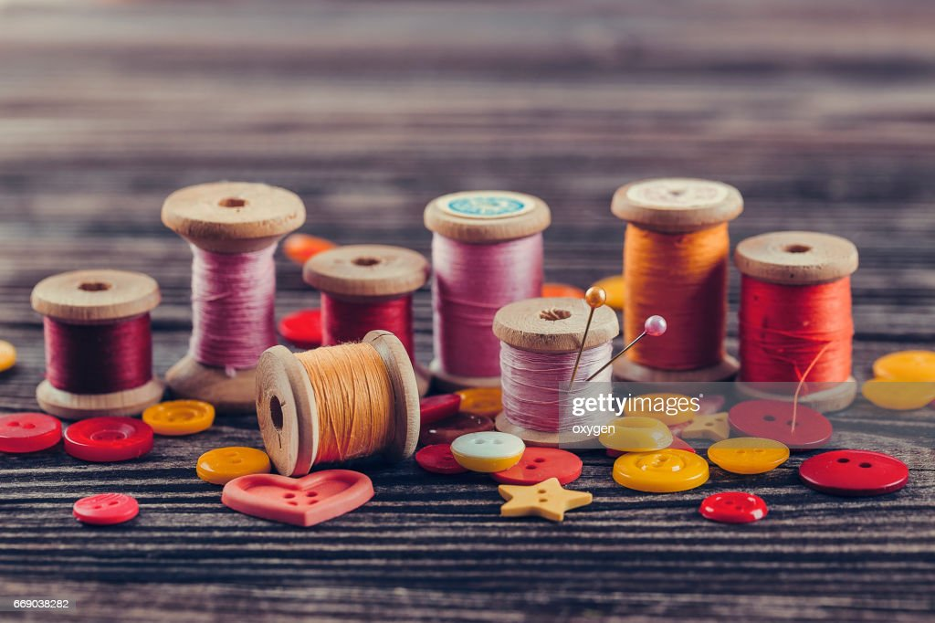 Collection of spools threads in yellow-pink colors : Stock Photo