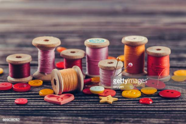 Collection of spools threads in yellow-pink colors