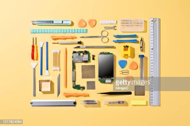 collection of tools for fixing mobile phone - maschinenteil hergestellter gegenstand stock-fotos und bilder