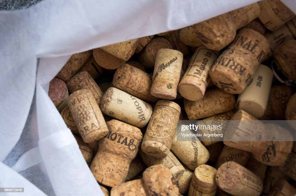 A collection of traditional cork closures (bottle corkstoppers) used for sealing wine bottles : Stock Photo