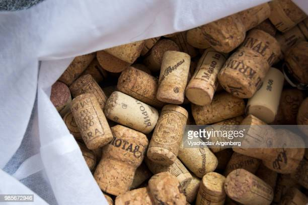 a collection of traditional cork closures (bottle corkstoppers) used for sealing wine bottles - cork stopper stock photos and pictures