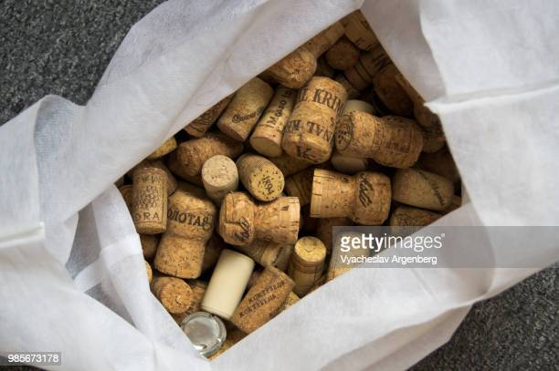 a collection of traditional cork closures (bottle corkstoppers) used for sealing wine bottles - argenberg stock-fotos und bilder