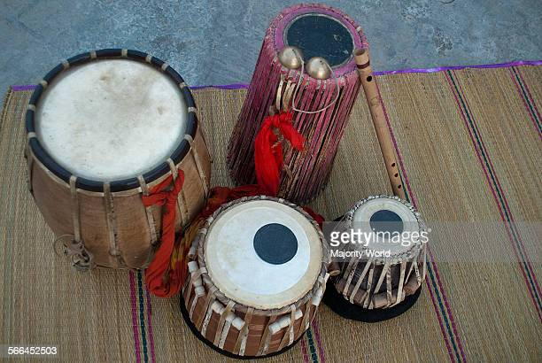 A collection of traditional musical instruments of Bangladesh Clockwise An Indian barrel drum or Dhol another type of Indian barrel drum known as...