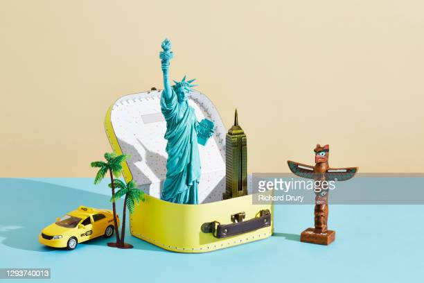 a collection of travel souvenirs in and around a suitcase - mid atlantic usa stock pictures, royalty-free photos & images