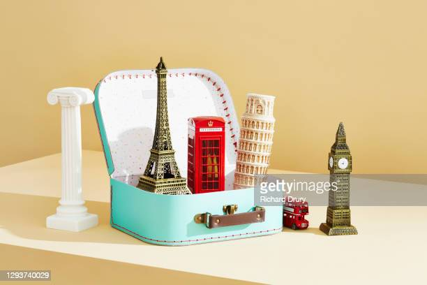 a collection of travel souvenirs in and around a suitcase - richard drury stock pictures, royalty-free photos & images