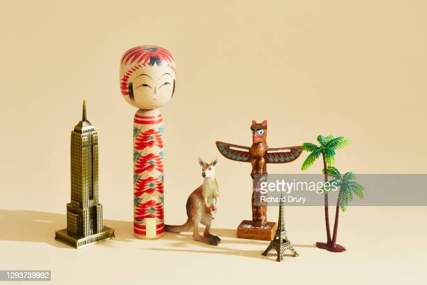 a collection of travel souvenirs - carving craft product stock pictures, royalty-free photos & images