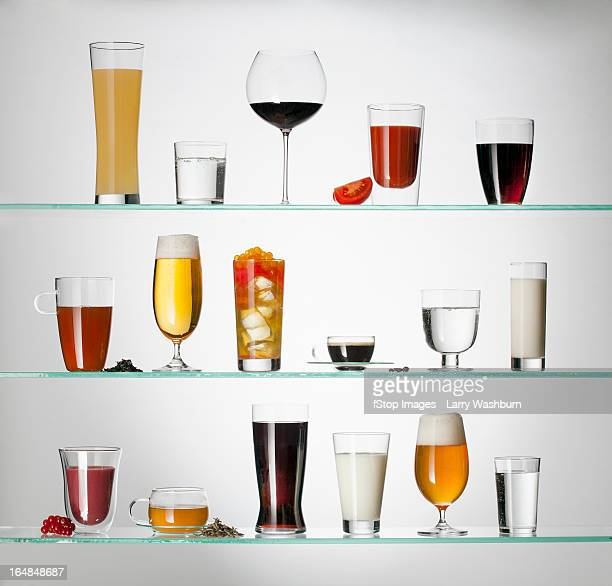 a collection of various types of drinking glasses filled with a variety of beverages - kaffee getränk stock-fotos und bilder