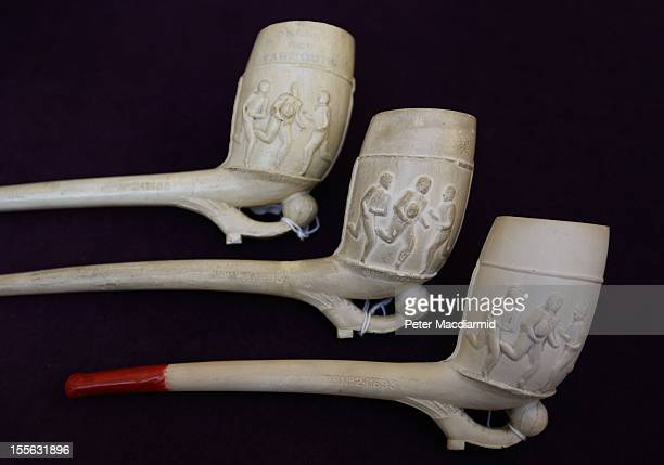 A collection of Victorian smokers pipes decorated with sporting releifs are shown at Sotheby's on November 6 2012 in London England Graham Budd...