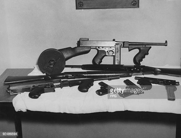A collection of weapons used at various times by American bank robber John Dillinger 25th July 1934 The guns which were taken by federal agents in...