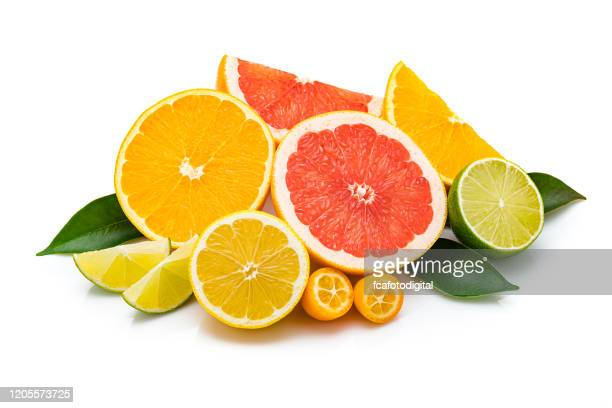 collection of whole and sliced citrus fruits isolated on white background - citrus fruit stock pictures, royalty-free photos & images