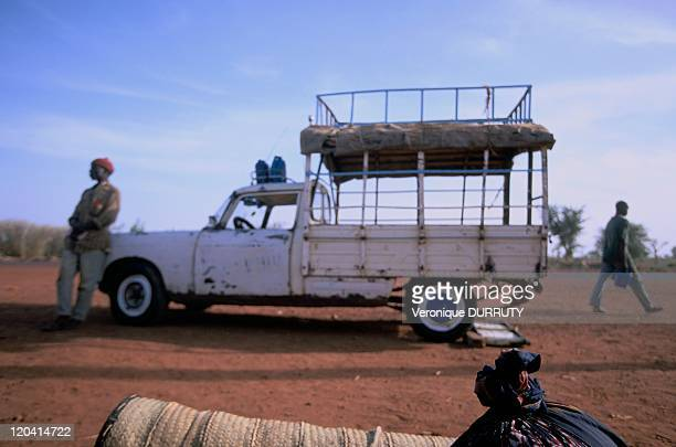 Collective of taxi 'Peugeot 404 Tarpaulin' in Mali When it is full it will go On the roof rack Two jerry cans of gasoline for refueling en route In...