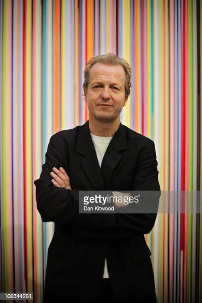 Collector Robert Devereux stands in front of a piece of work by British artist Ian Davenport entitled 'Poured Lines' at Sotheby's Auction House on...