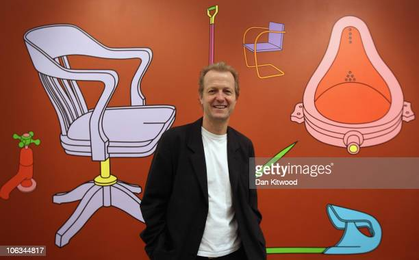 Collector Robert Devereux stands in front of a piece of work by British artist Michael CraigMartin entitled 'Common History Ready or Not' at...