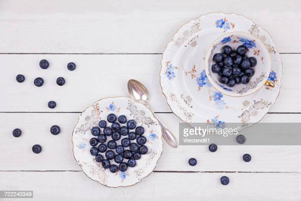 Collectors cupand plate of blueberries