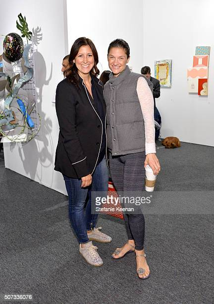 Collectors Lauren Taschen and Elizabeth Guber attend the Art Los Angeles Contemporary 2016 Opening Night at Barker Hangar on January 28 2016 in Santa...