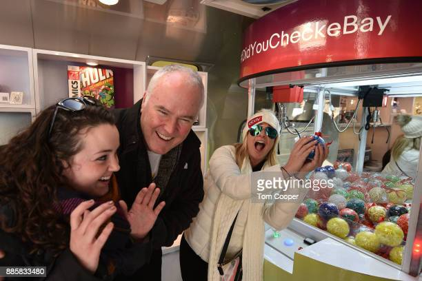 Colleen Cannan and Patrick Cannan of Buffalo New York winning an set of Apple Airpods and a fifty dollar Ebay gift card on the Ebay claw Machine...