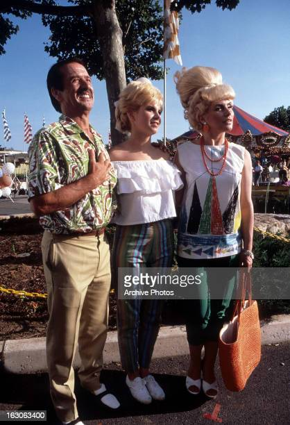 Colleen Fitzpatrick stands with her father and Deborah Harry in a scene from the film 'Hairspray' 1988