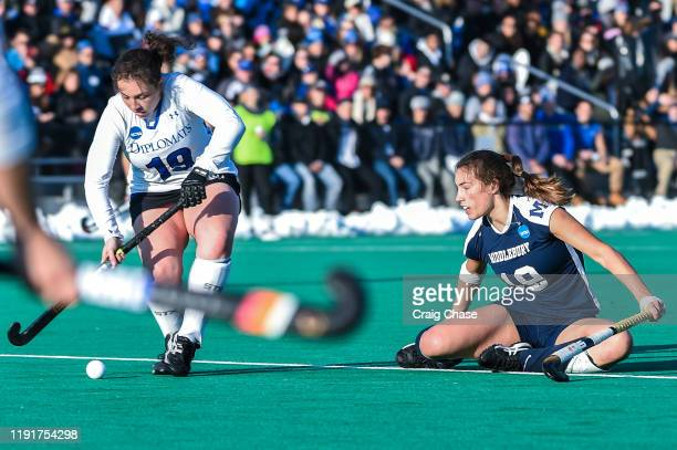 Colleen Francis of Franklin Marshall dribbles past Katie George of Middlebury against the Middlebury Panthers Katie George at the Division III...