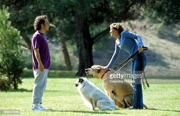 Colleen Haskell's dogs seem to be very interested in Rob Schneider in scene from the film 'The Animal' 2001