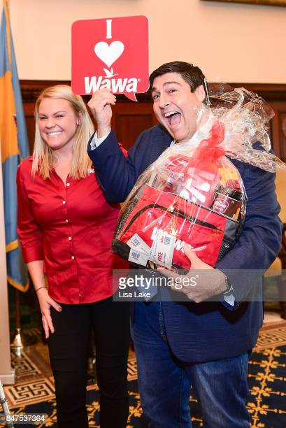 Colleen Labik Public Relations Coordinator for WAWA presents Producer Adam F Goldberg with gift basket during an event honoring Goldberg at...