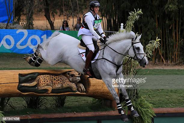 Colleen Loach of Canada riding Qorry Blue D'Argouges clears a jump during the Cross Country Eventing on Day 3 of the Rio 2016 Olympic Games at the...