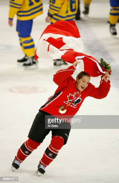 Colleen Sostorics of Canada waves a Canadian flag to celebrate their 4-1 victory over Sweden to win the gold medal in women's ice hockey during Day...