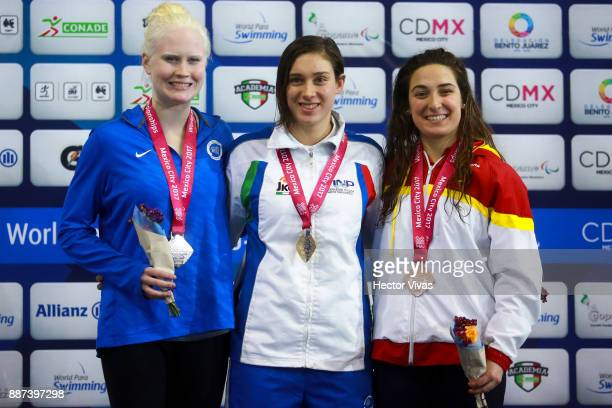 Colleen Young of USA Carlotta Gilli of Italy and Ariadna Edo Beltran of Spain pose after the Women's 200m Indiv Medley SM13 Final during day 5 of the...
