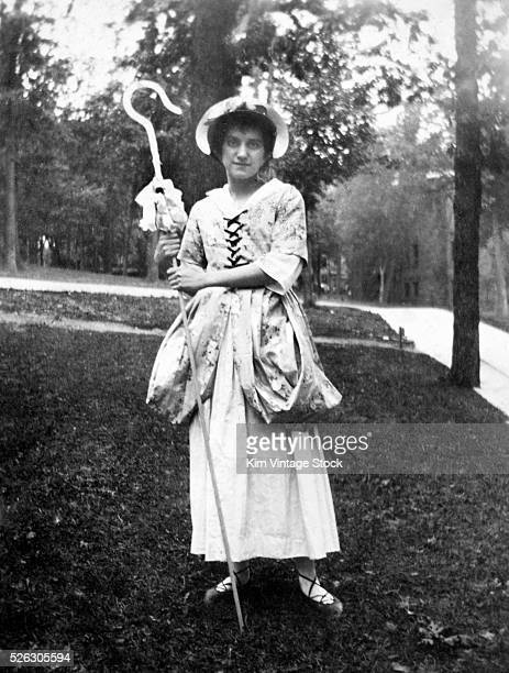 College age woman dressed as Little Bo Peep pose for a Halloween photo on the campus of the University of WisconsinMadison