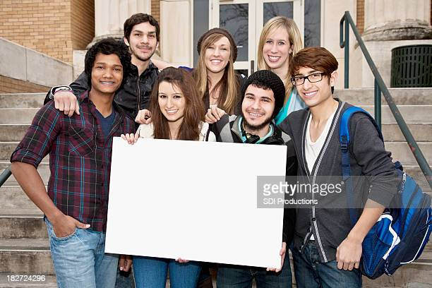 college aged students holding blank sign on campus - blank sign stock photos and pictures