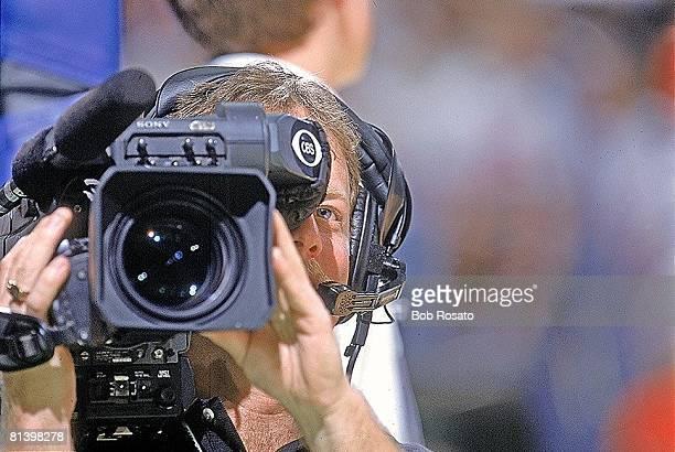 College Basketball 2002 NCAA playoffs Closeup of CBS media cameraman during Alabama vs Florida Atlantic game Greenville SC 3/14/2002