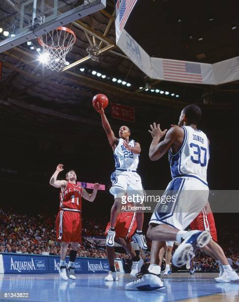 College Basketball ACC Tournament Duke Jason Williams in action taking layup vs North Carolina State during finals Charlotte NC 3/10/2002