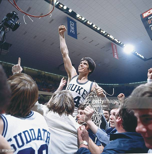College Basketball ACC Tournament Duke Jim Spanarkel victorious with net after winning game and tournament vs Wake Forest Greensboro NC 3/3/1978