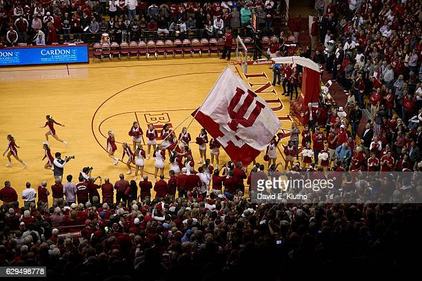 Aerial view of Indiana cheerleaders taking court with IU flags before game vs North Carolina at Assembly Hall Bloomington IN CREDIT David E Klutho