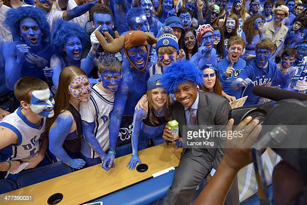 College Basketball Analyst Jay Williams poses for a photo with the Cameron Crazies of the Duke Blue Devils prior to a game against the North Carolina...