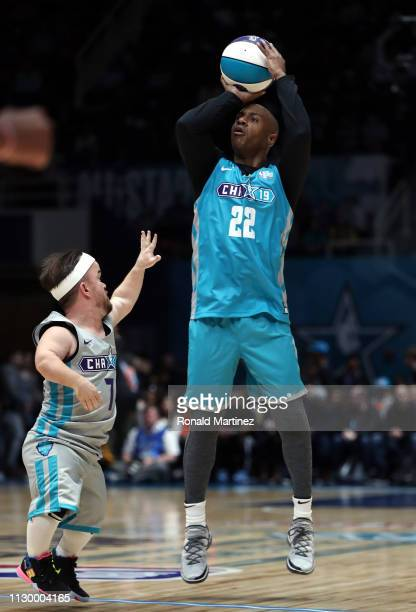 ESPN college basketball analyst Jay Williams takes a shot against comedian Brad Williams during the 2019 NBA AllStar Celebrity Game at Bojangles...