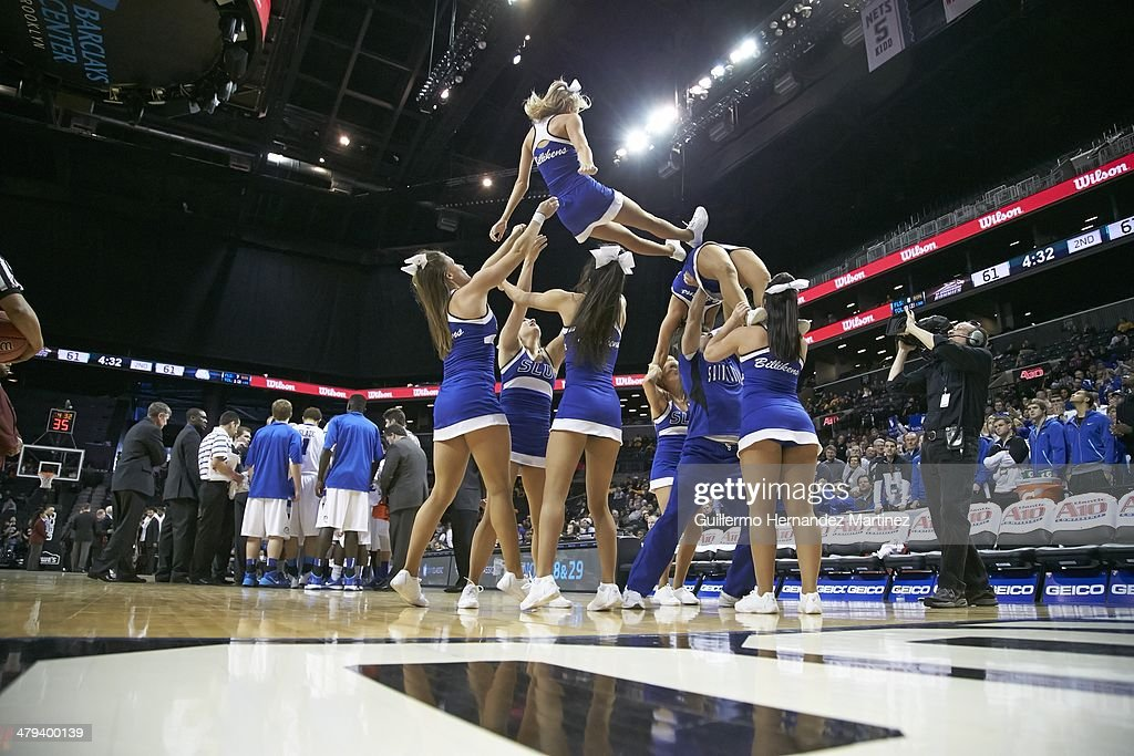 Saint Louis cheerleaders forming pyramid on court during game vs St. Bonaventure during Quarterfinals at Barclays Center. Guillermo Hernandez Martinez TK5 )