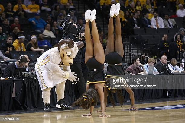 Atlantic 10 Tournament VCU Rams mascot Rodney the Ram with cheerleaders walking on hands during game vs Richmond during Quarterfinals at Barclays...