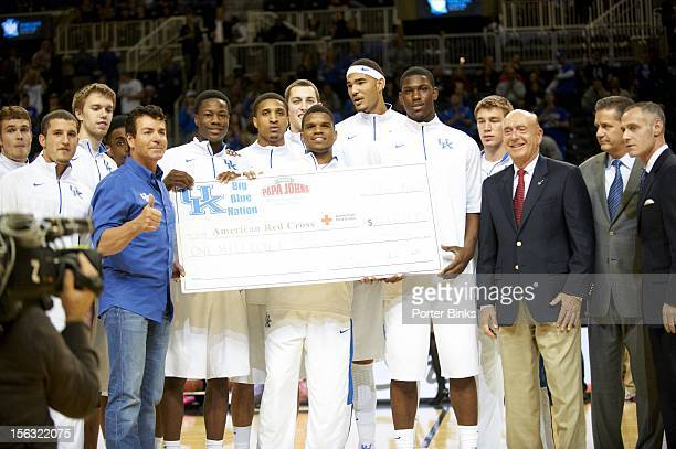 Barclays Center Classic Kentucky players and Papa John's CEO and founder John Schnatter presenting one million dollar check to Red Cross during game...