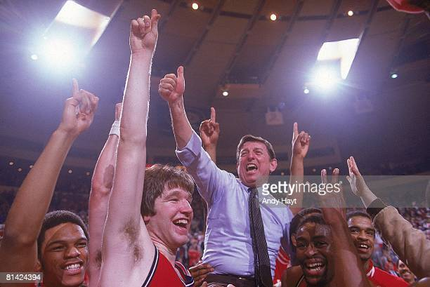 College Basketball: Big East Tournament, St, John's coach Lou Carnesecca victorious, getting carried off court by Chris Mullin , Kevin Williams , and...