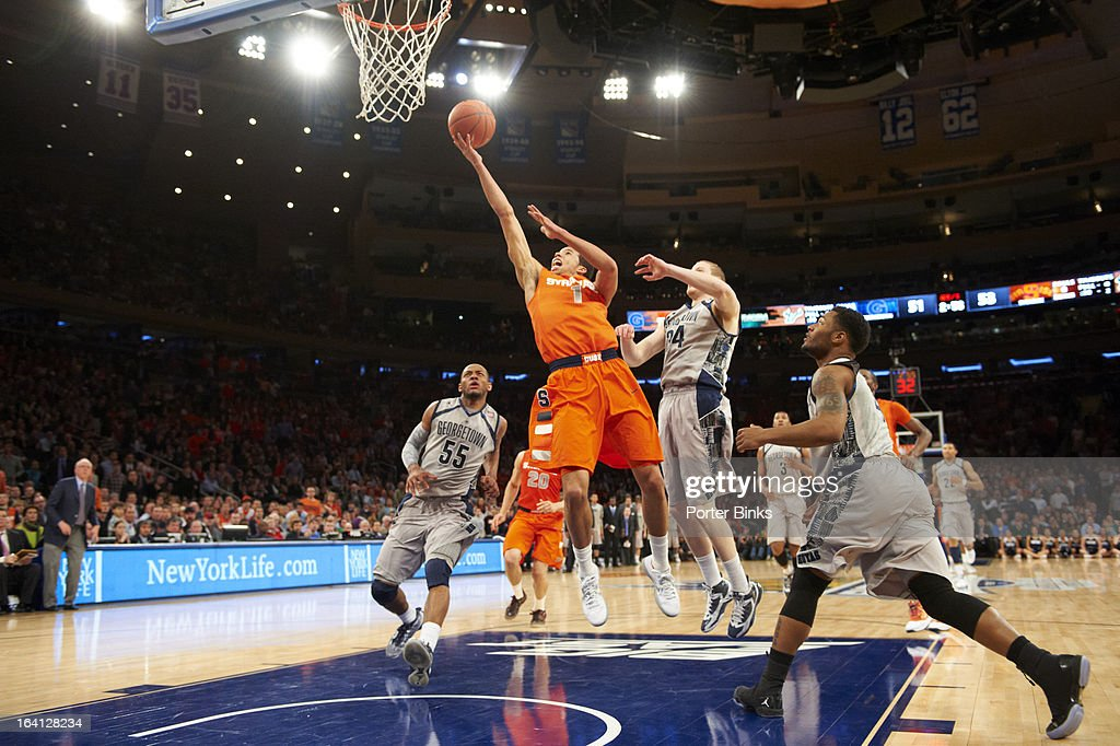 Syracuse Michael Carter-Williams (1) in action vs Georgetown during Semifinal game at Madison Square Garden. Porter Binks F15 )
