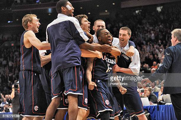 Big East Tournament UConn Kemba Walker victorious with teammates after making last second game winning shot for buzzer beater vs Pittsburgh at...