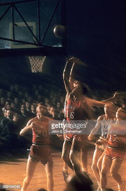 Blur view of St Louis Hawks Cliff Hagan Ed Macauley and Med Park in action vs New York Knicks at Madison Square Garden New York NY CREDIT John G...