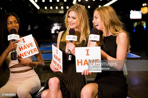Bracket Challenge Party Portrait of SI Swimsuit models Ebonee Davis Megan Williams and Caroline Kelley being interviewed during event at Slate New...