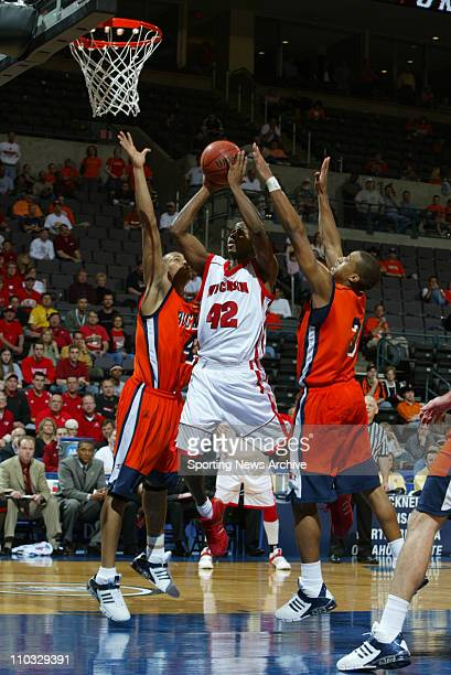 College Basketball Bucknell Donald Brown Charles Lee against Wisconsin Alando Tucker during the second round of the NCAA Tournament in Oklahoma City...