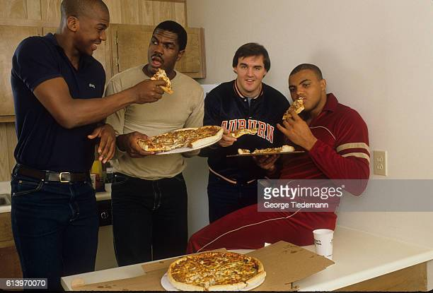 Casual portrait of Auburn Charles Barkley at home eating pizza with Chuck Person and teammates during photo shoot Auburn AL CREDIT George Tiedemann